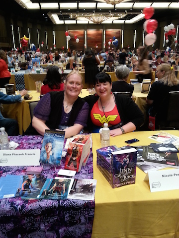 Nicole and me signing